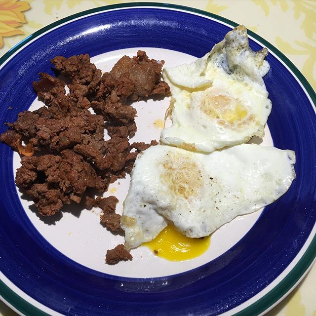 Breakfast of champions.. 4 oz of Carne Asada and 2 eggs cooked in Coconut oil. Yummy in my tummy. 34 g of protein and 1 g of carbs